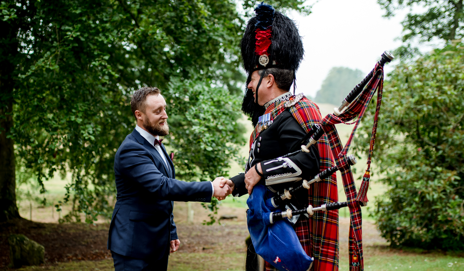 groom shakes pipers hand